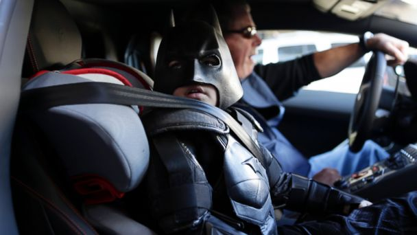 "PHOTO: Miles Scott, 5, dressed as Batkid, waits in a Lamborghini ""Batmobile"" as he and Batman get ready to stop a bank robbery in San Francisco, Nov. 15, 2013."