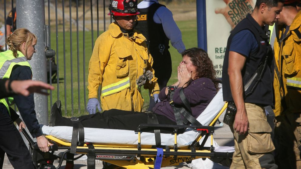 A victim is wheeled away on a stretcher following a shooting that killed multiple people at a social services facility, Dec. 2, 2015, in San Bernardino, Calif.