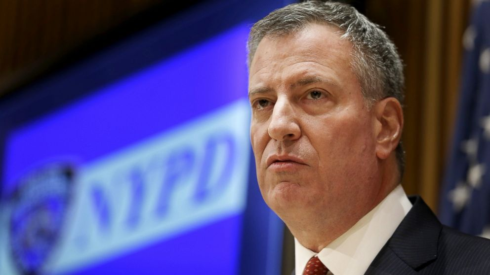 New York City Mayor Bill de Blasio listens during a news conference at police headquarters in New York, Dec. 22, 2014.
