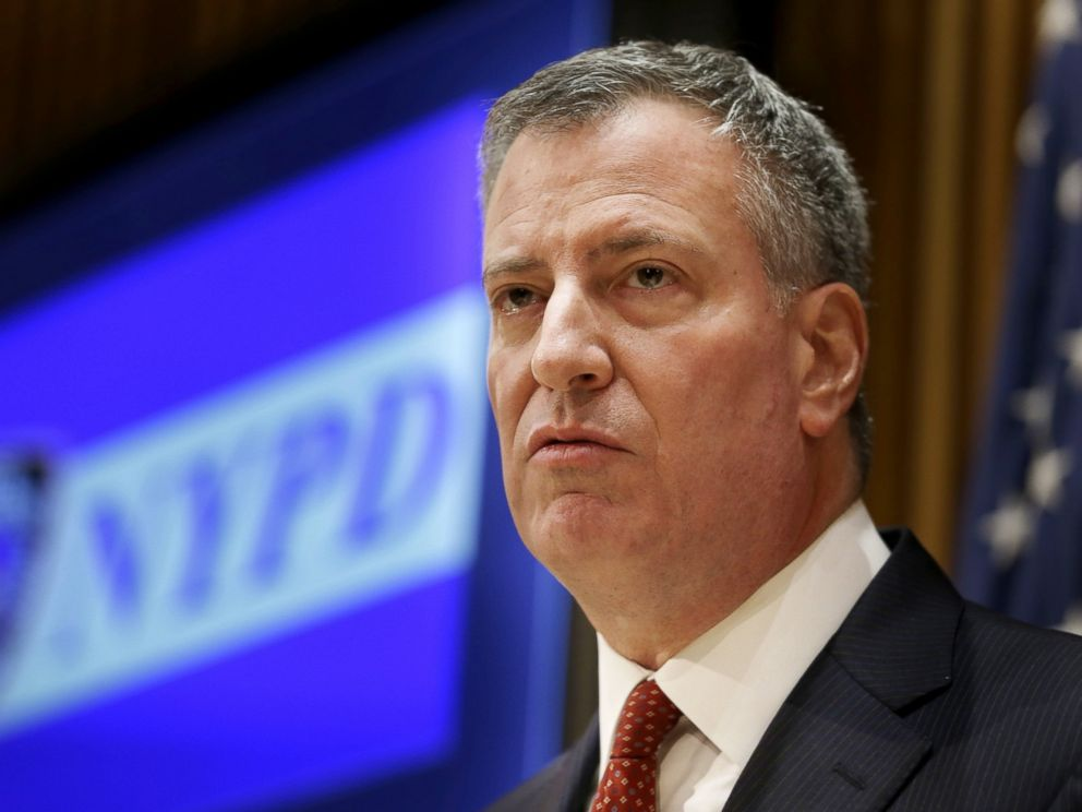 PHOTO: New York City Mayor Bill de Blasio listens during a news conference at police headquarters in New York, Dec. 22, 2014.