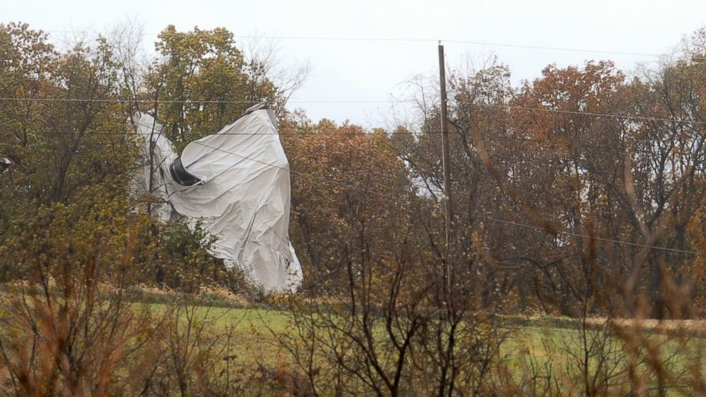Part of an Army surveillance blimp hangs off a group of trees on Oct. 28, 2015 after crash landing near Muncy, Pa.