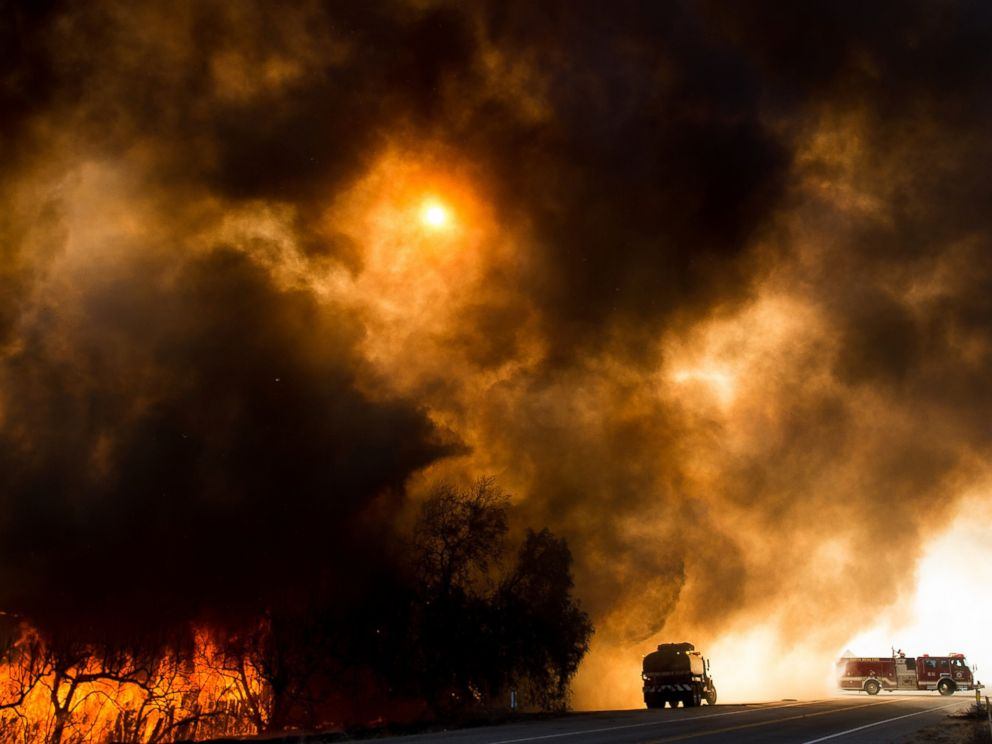 PHOTO: Firefighters battle a wildfire as it crosses Cajon Boulevard in Keenbrook, California, Aug. 17, 2016.
