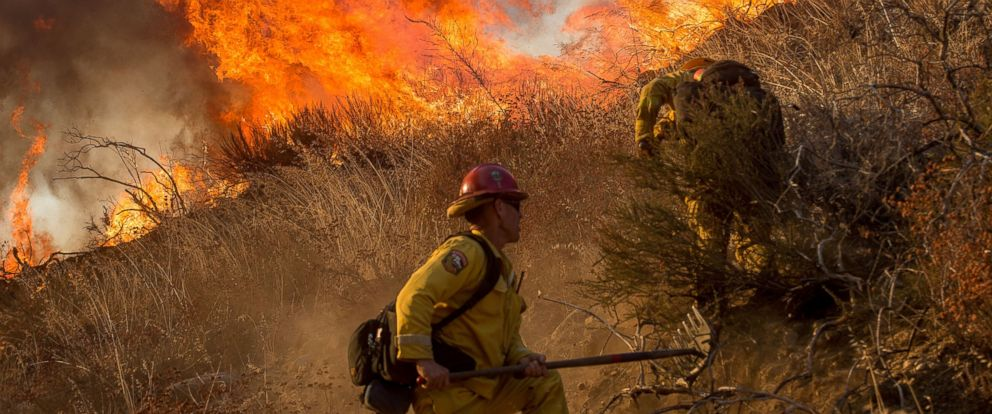 PHOTO: Firefighters battle a wildfire on Cajon Boulevard in Keenbrook, California, Aug. 17, 2016.