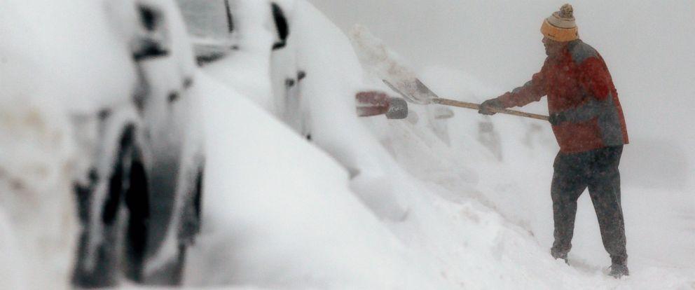 PHOTO: A man shovels snow in the East Boston neighborhood of Boston, Sunday, Feb. 15, 2015.