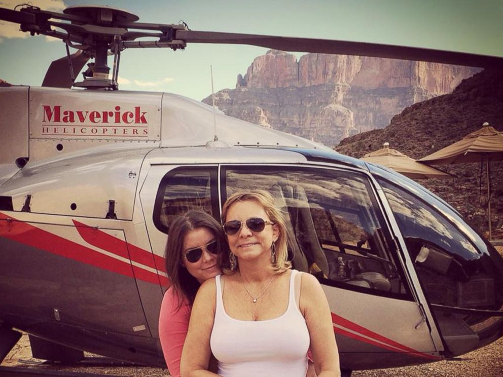 PHOTO: Brittany Maynard, left, hugs her mother, Debbie Ziegler, next to a helicopter at the Grand Canyon National Park in Arizona, Oct. 21, 2014.