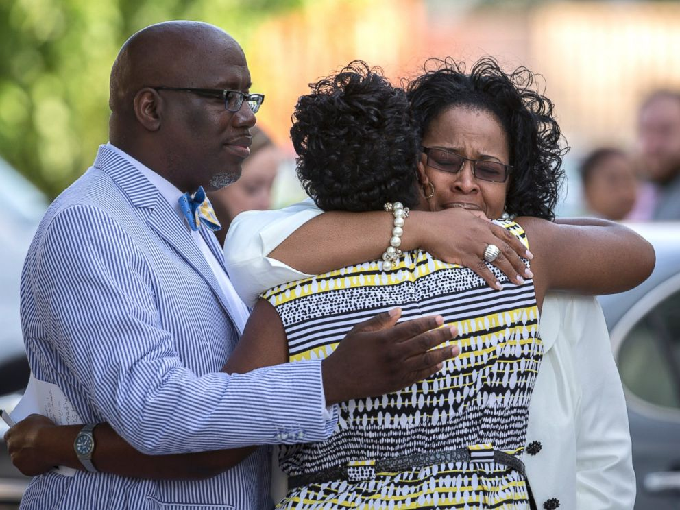 PHOTO: A group of church members greet each other before entering the Emanuel AME Church for a worship service, June 21, 2015, in Charleston, S.C.