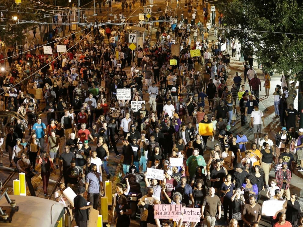 PHOTO: Demonstrators protest Tuesdays fatal police shooting of Keith Lamont Scott in Charlotte, North Carolina on Sept. 21, 2016. Protesters rushed police in riot gear at a downtown Charlotte hotel and officers have fired tear gas to disperse the crowd.