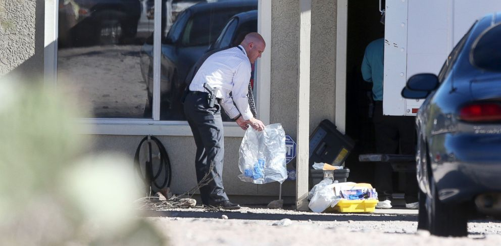 PHOTO: Tucson Police Department investigators and evidence technicians investigate the scene at a home where two people were arrested, Nov. 26, 2013.