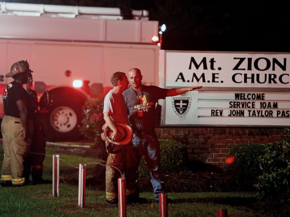 PHOTO: Public safety personnel talk outside Mount Zion African Methodist Episcopal church, June 30, 2015, in Greeleyville, S.C.