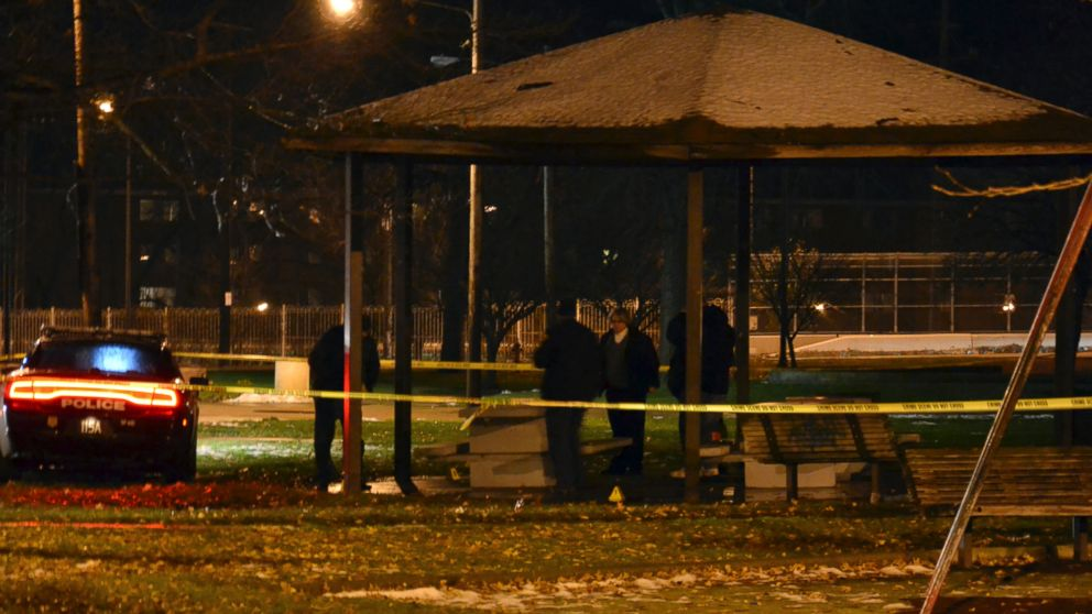 Cleveland police investigate a scene after an officer fired two shots, killing 12-year-old Tamir E. Rice, who police said pulled a gun from his waistband, Nov. 22, 2014.
