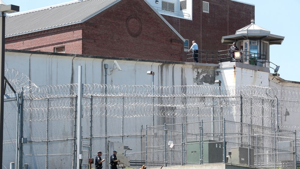 Law enforcement officers with bloodhounds stand guard at one of the entrances to the Clinton Correctional Facility in Dannemora, N.Y. on Saturday, June 6, 2015.