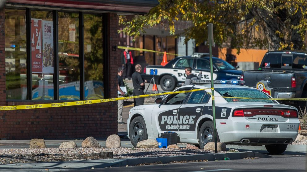 The rear window of a Colorado Springs Police car is shattered after a shooting, Oct. 31, 2015, in Colorado Springs, Colo.