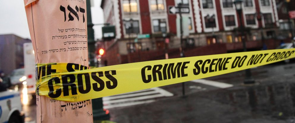 PHOTO: Crime scene tape is wrapped around a pole in front of Chabad-Lubavitch Hasidic headquarters, Dec. 9, 2014, in New York.