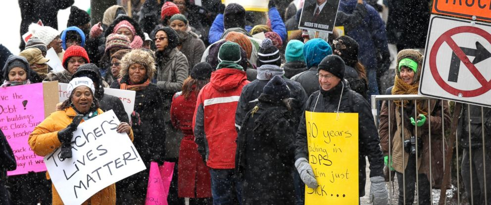 PHOTO: Protesters wait to cross the street on Jan. 20, 2016, in Detroit. Most of Detroits public schools closed for the day due to teacher absences, as disgruntled educators stepped up efforts to protest the governors plans for the district.