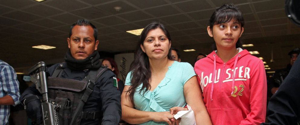 PHOTO: Houston resident Dorotea Garcia, center, and 13-year-old Alondra Diaz are escorted by police as they arrive at the international airport in Guadalajara, Mexico, early Saturday May 16, 2015.