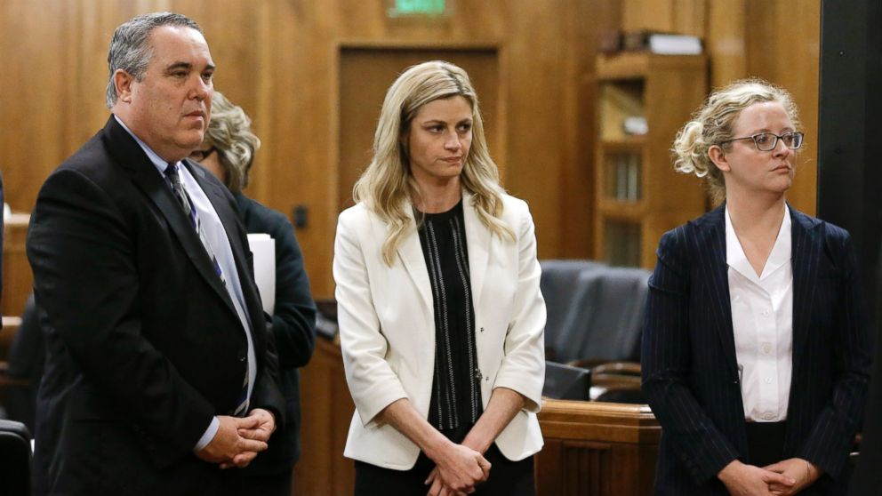 Erin Andrews, center, stands with attorney Scott Carr, left, as the jury leaves the courtroom, Feb. 25, 2016, in Nashville, Tenn.