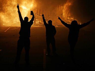 PHOTO: People watch as stores burn, Nov. 25, 2014, in Ferguson, Mo.
