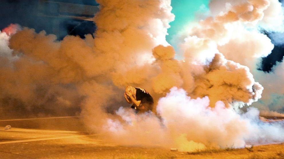 Violence in Ferguson: Police Fire Tear Gas, Smoke Bombs at