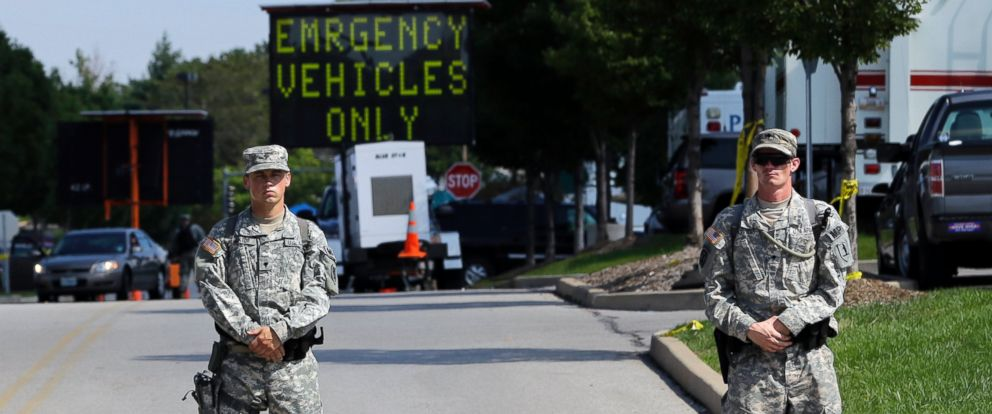 PHOTO: Members of the Missouri National Guard secure the perimeter of a police command post, Aug. 19, 2014, in Ferguson, Mo.
