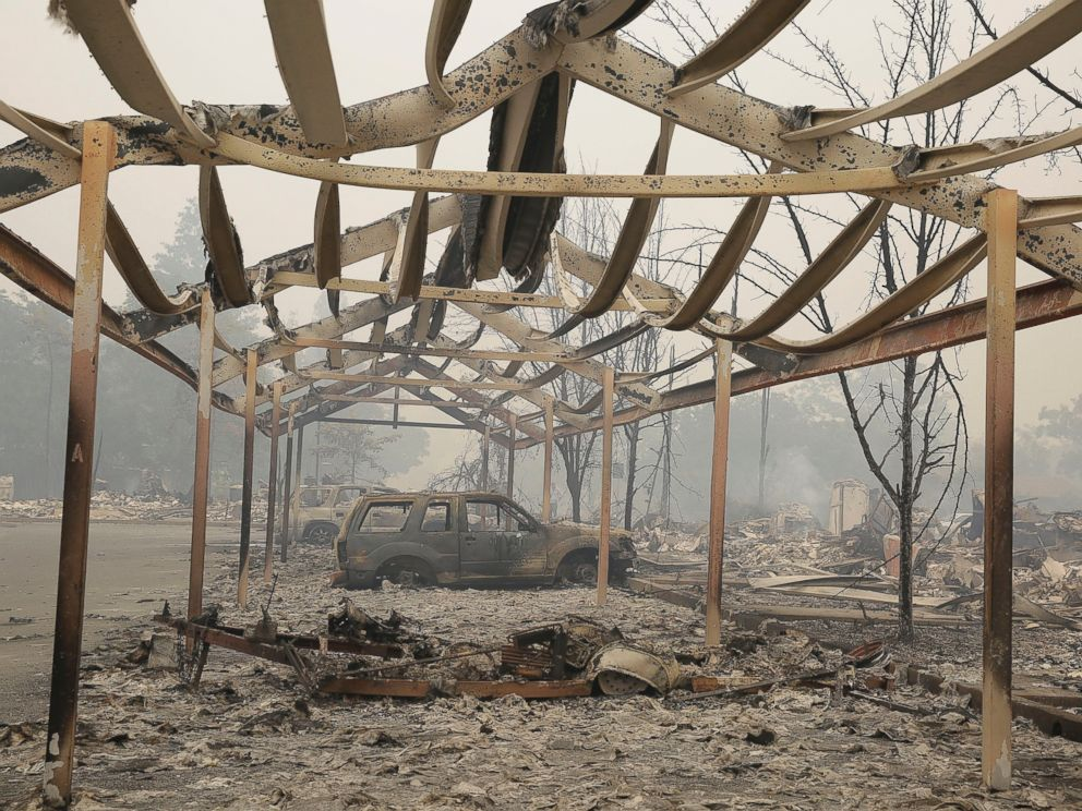 PHOTO:A carport frame and burned cars remain outside an apartment complex destroyed by fire, Sept. 13, 2015, in Middletown, Calif.