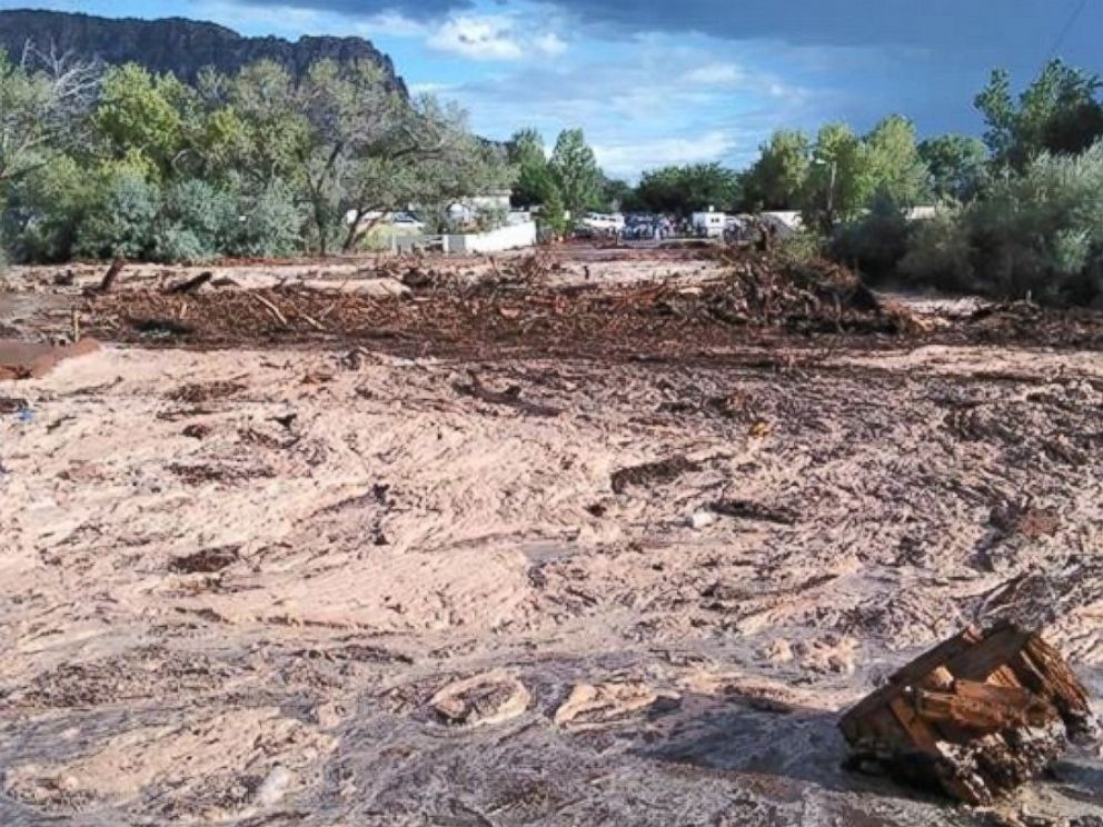 PHOTO:Debris and water cover the ground after a flash flood, Sept. 14, 2015, in Hildale, Utah