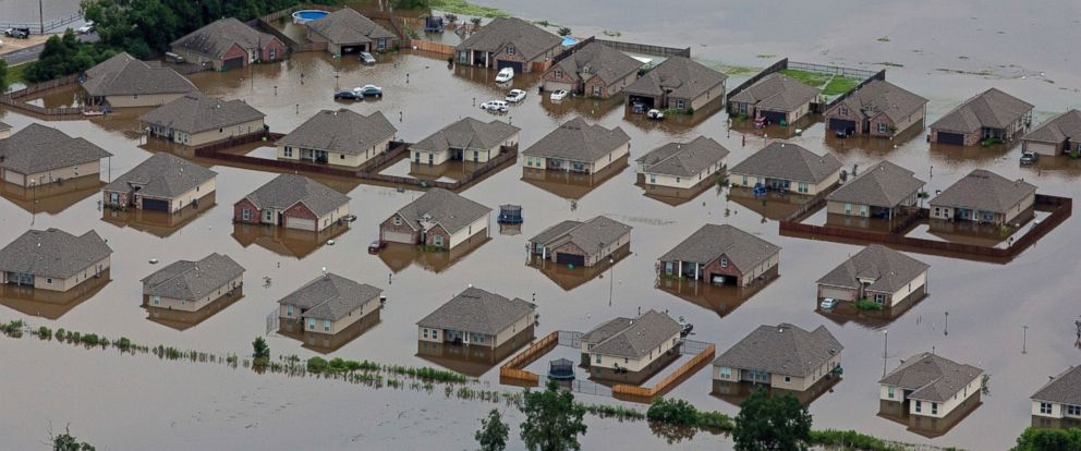 PHOTO: In this aerial photo over Hammond, La., flooded homes are seen off of LA-1064 after heavy rains inundated the region, Aug. 13, 2016.