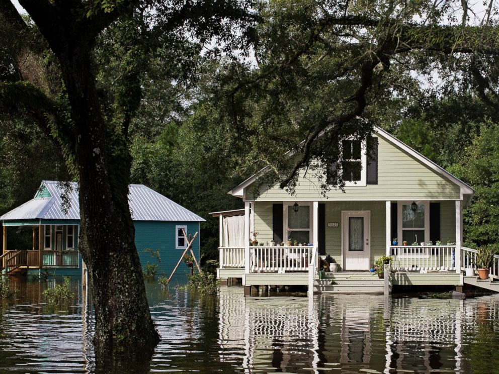 PHOTO: Floodwaters reach the front steps of homes built on pillars near Holden, La., after heavy rains inundated the region, Aug. 14, 2016.