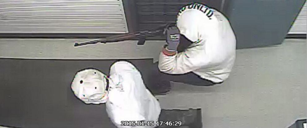 PHOTO: Two suspects with a rifle are seen in this in this security camera video grab as they rob a pawn shop, Jan, 15, 2015, in Haines City, Fla.