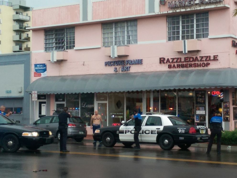 PHOTO: In this photo provided by Marcellus Johnson, authorities draw their guns on a man suspected in a bank robbery, Dec. 5, 2015, in Miami Beach, Fla.