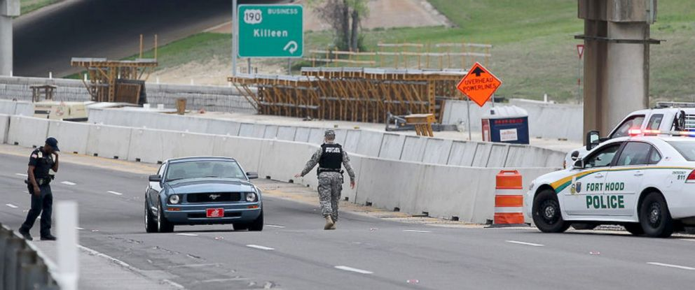 PHOTO: A military police officer stops a car at Fort Hood, Texas, after a shooting on the Army base, April 2, 2014.
