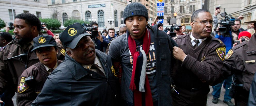 PHOTO: A demonstrator is detained outside of the courthouse after a mistrial of Officer William Porter, one of six Baltimore city police officers charged in connection to the death of Freddie Gray, Dec. 16, 2015, in Baltimore.