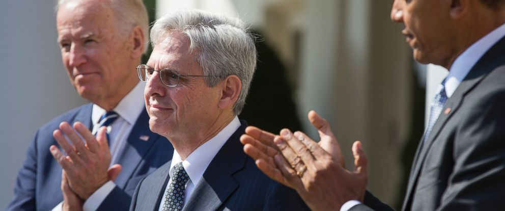 PHOTO: Federal appeals court judge Merrick Garland, center, stands as President Barack Obama, right, and Vice President Joe Biden applaud as he is introduced as Obama?s nominee for the Supreme Court, March 16, 2016, in Washington.