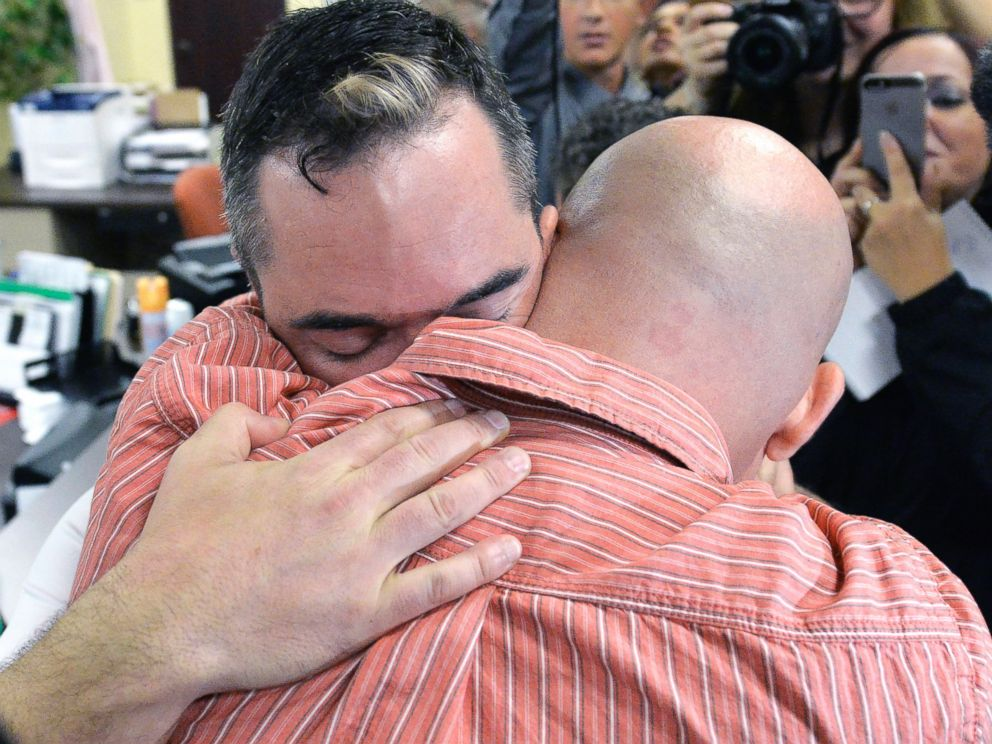 PHOTO: James Yates, left, hugs his partner William Smith Jr., after receiving their marriage license at the Rowan County Judicial Center in Morehead, Ky., Sept. 4, 2015.