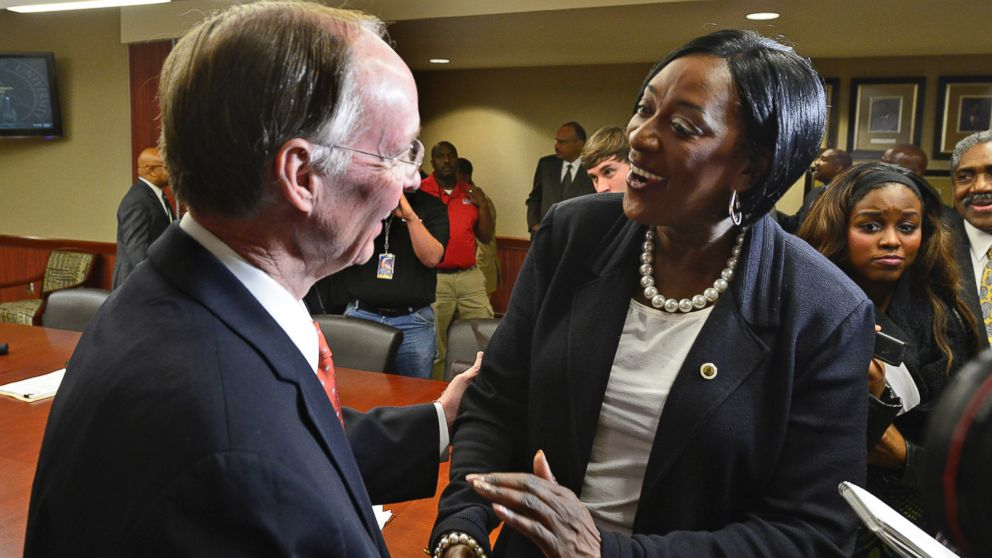 In this file photo, Gwendolyn Boyd, right, greets Alabama Gov. Robert Bentley, left, after the Alabama State University Board of Trustees offered her the presidency of the university on Dec. 20, 2013, at the ASU campus in Montgomery, Ala.