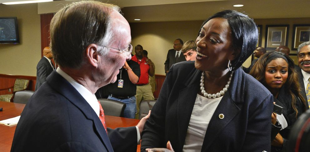 PHOTO: In this file photo, Dr. Gwendolyn Boyd, right, greets Alabama Governor Robert Bentley, left, after the Alabama State University Board of Trustees offered her the presidency of the university on Dec. 20, 2013 at the ASU campus in Montgomery, Ala.