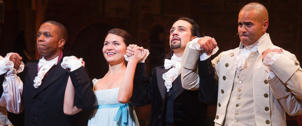"""PHOTO: Leslie Odom Jr., from left, Phillipa Soo, Lin-Manuel Miranda and Christopher Jackson appear at the curtain call following the opening night performance of """"Hamilton"""" at the Richard Rodgers Theatre in New York, Aug. 6, 2015."""