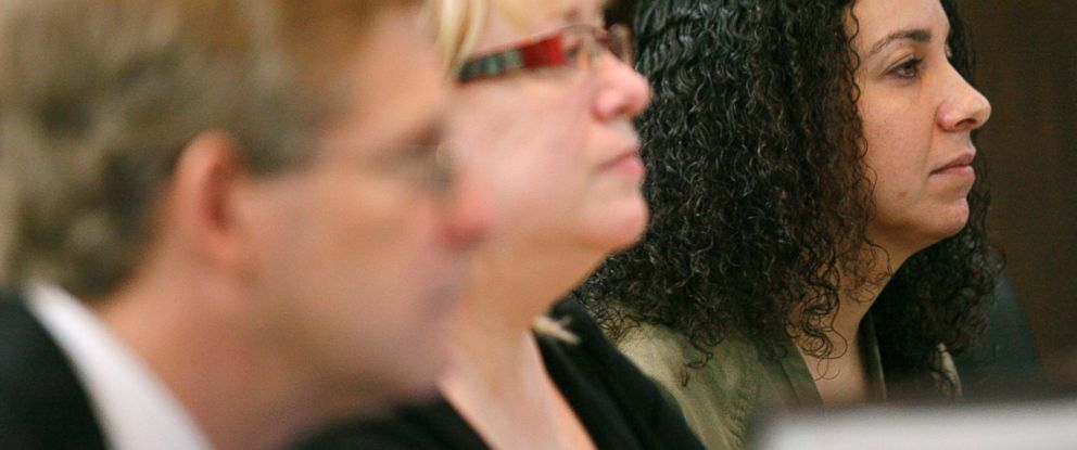 PHOTO: Hannah Overton, far right, sits next to her attorney, Cynthia Orr, center, and prosecutor, Doug Norman, April 26, 2012 in Corpus Christi, Texas.
