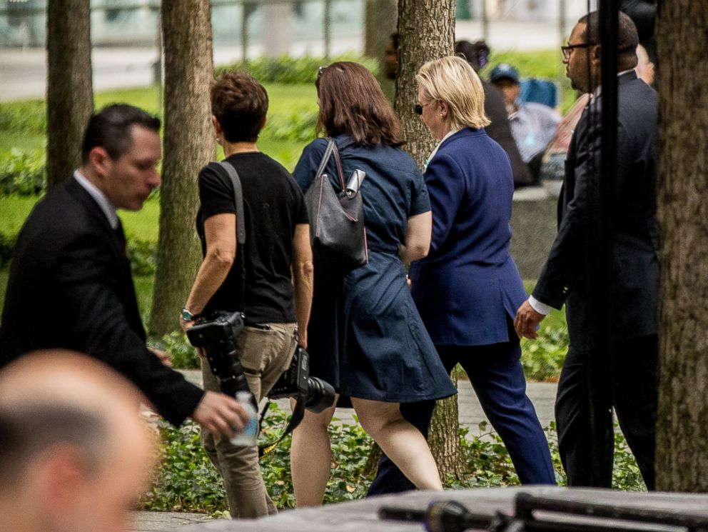 PHOTO: Democratic presidential candidate Hillary Clinton, second from right, departs after attending a ceremony at the Sept. 11 memorial, in New York, Sept. 11, 2016, on the 15th anniversary of the Sept. 11 attacks.