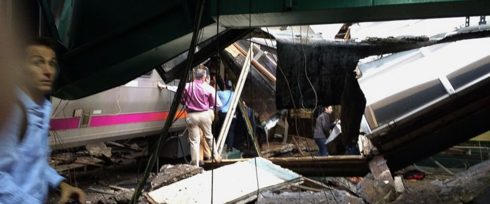 PHOTO: People examine the wreckage of a New Jersey Transit commuter train that crashed into the train station during the morning rush hour in Hoboken, New Jersey, Sept. 29, 2016.