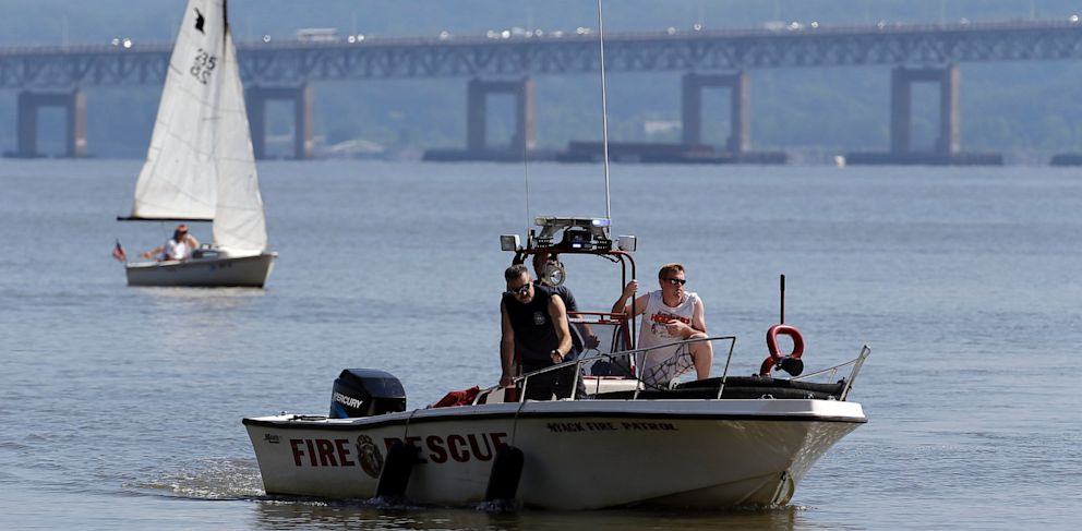 PHOTO: Rescue workers on a boat search the Hudson River south of the Tappan Zee Bridge for two people who are believed to have fallen into the water during a boat crash in Piermont, N.Y. on Saturday, July 27, 2013.