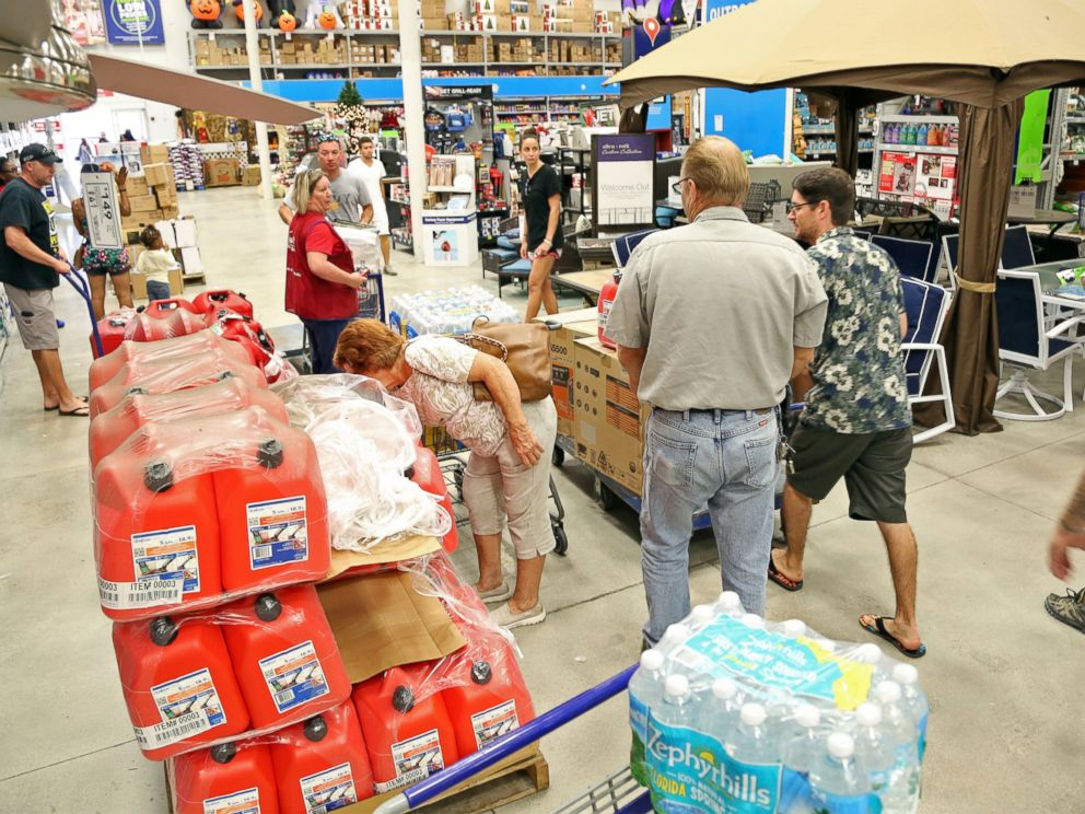 PHOTO: Shoppers look for items amid the generators, cases of water and gas cans at Lowes in Oakland Park, Florida, Oct. 4, 2016.