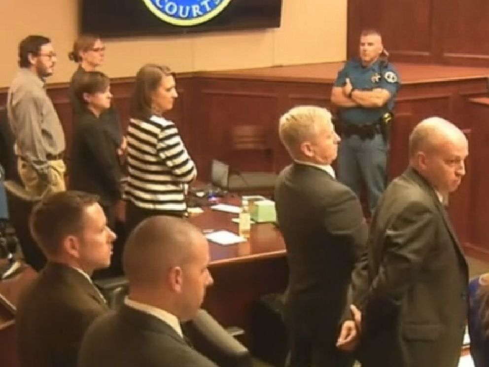 PHOTO: Defendant James Holmes, top left in tan shirt, defense attorneys and prosecuting attorneys watch as the jury exits the courtroom after delivering their sentencing verdict in the Colorado theater shooting trial in Centennial, Colo.,Aug. 7, 2015.