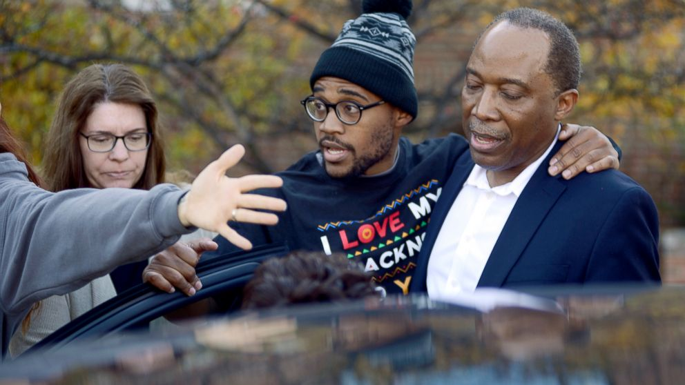 Jonathan Butler, center, enters a car as he leaves the University of Missouri campus, Nov. 9, 2015, after he ended his hunger strike in Columbia, Mo.
