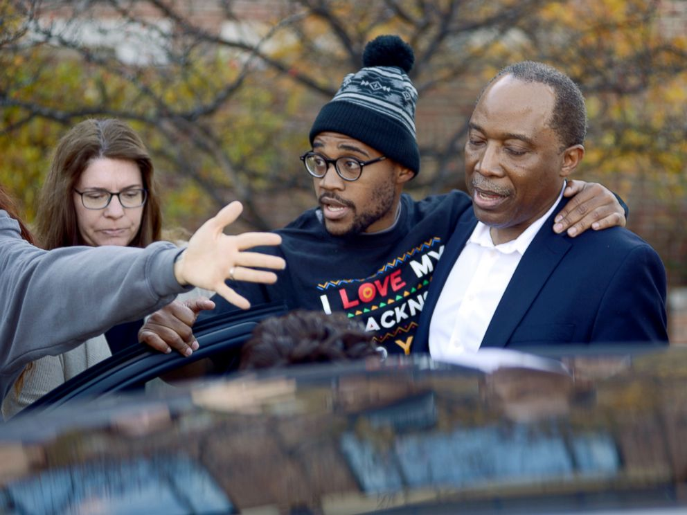 PHOTO: Jonathan Butler, center, enters a car as he leaves the University of Missouri campus, Nov. 9, 2015, after he ended his hunger strike in Columbia, Mo.