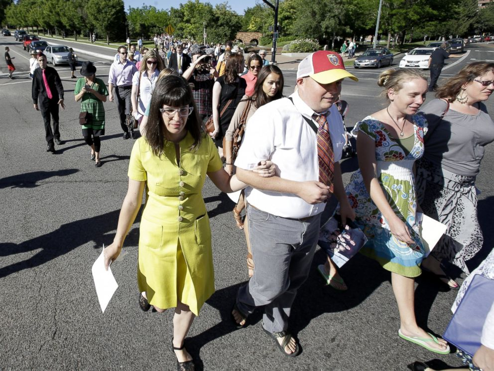 PHOTO: Kate Kelly, left, walks with supporters to the Church Office Building of the Church of Jesus Christ of Latter-day Saints, June 22, 2014, in Salt Lake City.