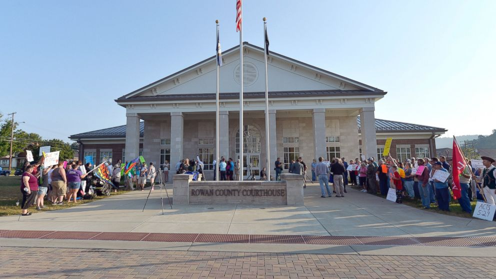 A gathering of same sex marriage supporters, left, and supporters of Rowan County Clerk Kim Davis, right, face off in front of the Rowan County Courthouse, Sept. 1, 2015, in Morehead, Ky.