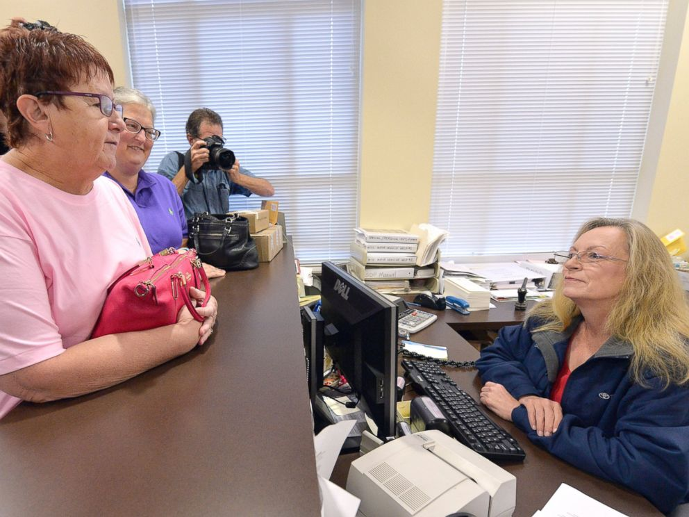 PHOTO:Karen Roberts, left, and her partner, April Miller, speak to Assistant Rowan County Clerk Kim Russell as they attempt to get a marriage license, Sept. 1, 2015, at the Rowan County Courthouse in Morehead, Ky.