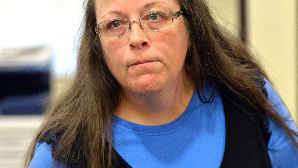 Rowan County Clerk Kim Davis listens to a customer following her office's refusal to issue marriage licenses, Sept. 1, 2015,at the Rowan County Courthouse in Morehead, Ky.