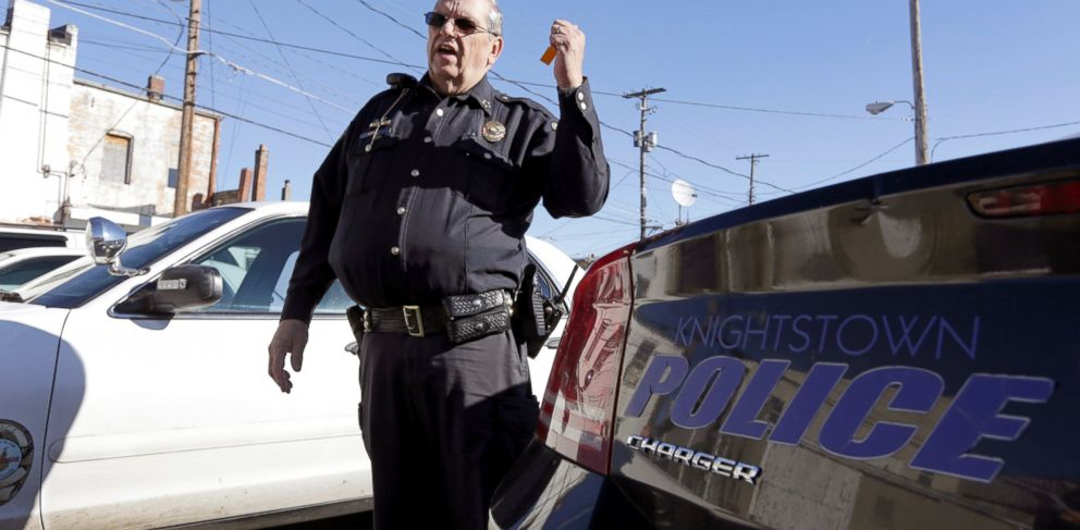 PHOTO: Knightstown Police Chief Danny Baker talks about the condition of the departments patrol cars outside the station in Knightstown, Ind. Baker is trying to raise money to lease a new car for the department by agreeing to be shot with his Taser.