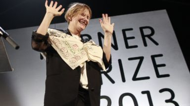 PHOTO: Laure Prouvost celebrates after winning the Turner Prize 2013